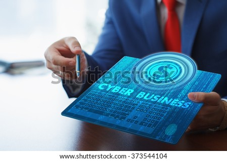 Business, technology, internet and networking concept. Young businessman working on his tablet in the office, select the icon cyber business on the virtual display. - stock photo