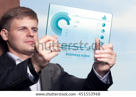 Business, technology, internet and networking concept. Young businessman working on his tablet in the office - stock photo