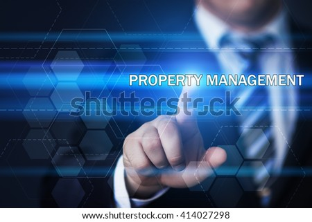 Business, technology, internet and property management concept. Businessman pressing property management button on virtual screens with hexagons and transparent honeycomb - stock photo