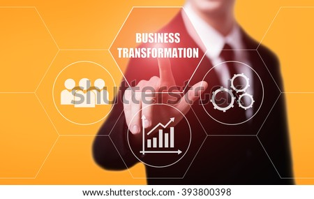 business, technology, internet and virtual reality concept - businessman pressing business transformation button on virtual screens with hexagons and transparent honeycomb - stock photo
