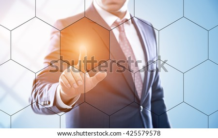 business, technology, internet and virtual reality concept - businessman pressing button on virtual screens with hexagons and transparent honeycomb. Template for text. - stock photo