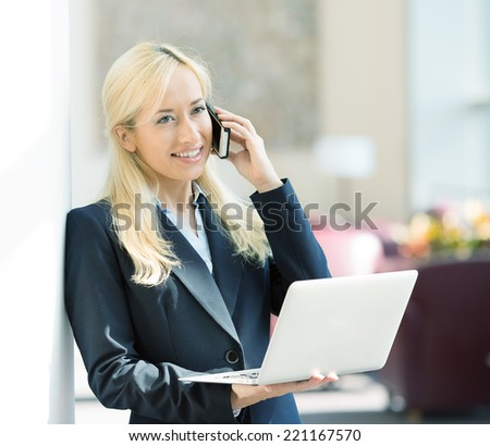 Business technology internet concept, customer service. Happy smiling businesswoman working on tablet pc computer calling on phone isolated background corporate office hallway. Positive expression - stock photo