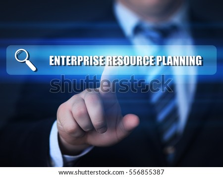 Business, technology, internet concept on hexagons and transparent honeycomb background. Businessman  pressing button on touch screen interface and select  erp