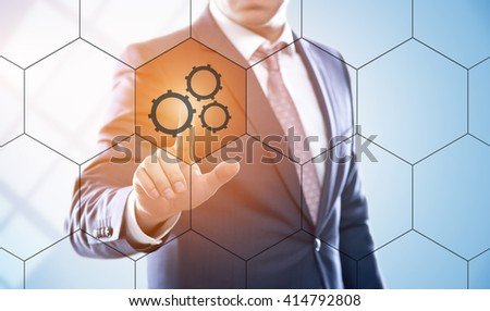 business, technology, internet, engineering and virtual reality concept - businessman pressing mechanism button on virtual screens with hexagons and transparent honeycomb - stock photo