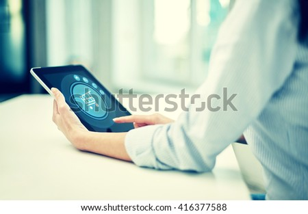 business, technology, online shopping and people concept - close up of woman with tablet pc computer at office or home - stock photo
