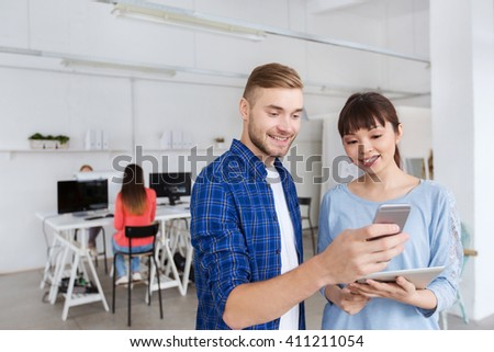 business, technology, people and concept - smiling creative team with smartphone and tablet pc computer at office - stock photo