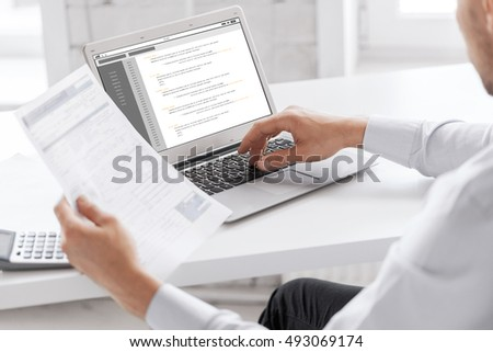 business, technology, programming and people concept - close up of businessman with coding on laptop computer screen working at office