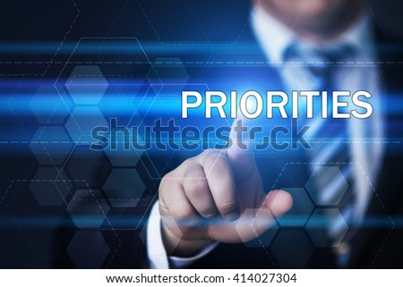 business, technology, project, motivation and virtual reality concept - businessman pressing priorities button on virtual screens with hexagons and transparent honeycomb - stock photo