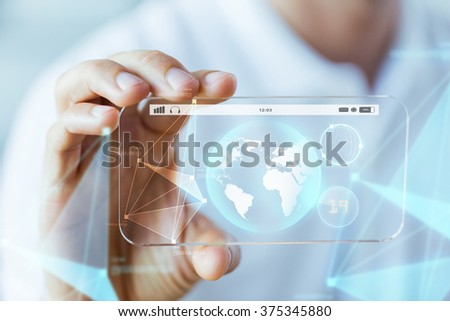 business, technology, science and people concept - close up of male hand holding and showing transparent smartphone earth globe projection - stock photo