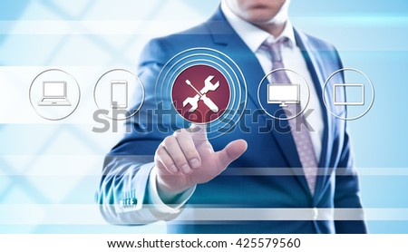 business, technology, technical support, repair devices and internet concept - businessman pressing screwdriver and wrench button on virtual screens - stock photo
