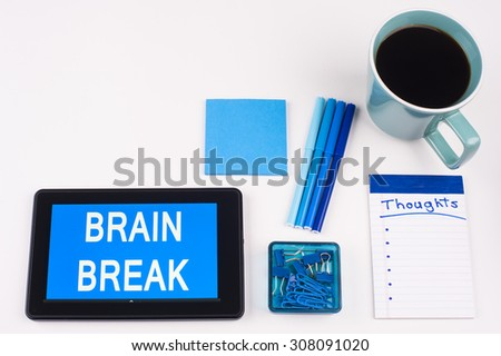 Business Term / Business Phrase on Tablet PC - Blue Colors, Coffee, Pens, Paper Clips and note pads on White - White Word(s) on blue - Brain Break - stock photo