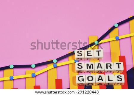 Business Term with Climbing Chart / Graph - Set Smart Goals - stock photo