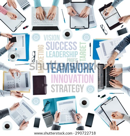 Business text concepts and business team working at office desk during a meeting, hands top view, unrecognizable people, strategy and teamwork concept - stock photo