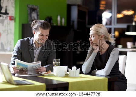 Business the partners eating at restaurant - stock photo