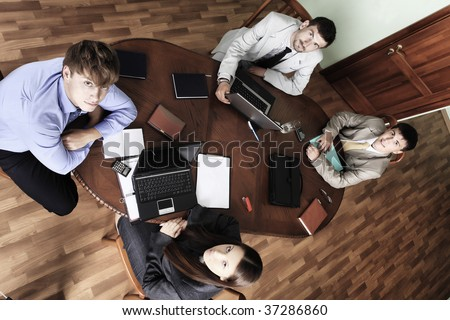Business theme: business people in a work process in office. - stock photo