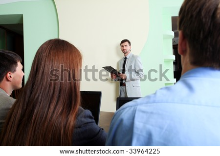 Business theme: business people on a presentation. - stock photo