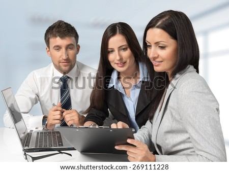 Business. Three business colleagues sitting together - stock photo