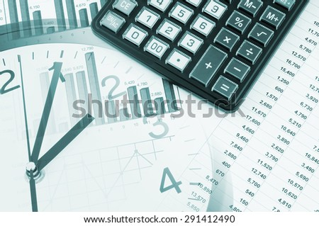 Business time concept, calculator on financial documents and clock