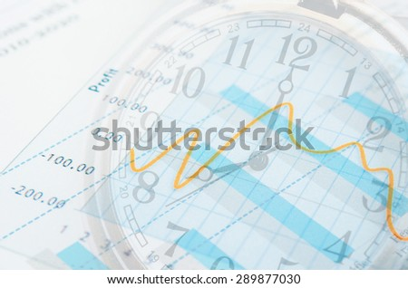 Business time concept. Graph document and clock. - stock photo