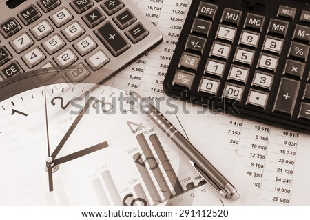 Business time concept, two calculators on documents and clock - stock photo