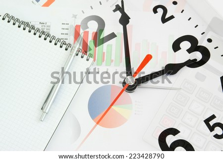 Business time concept with calculator, clock and documents  - stock photo