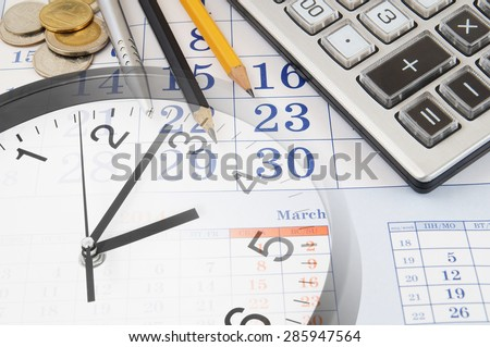 Business time concept with calendar and calculator - stock photo