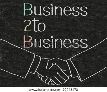 business to business B2B written on blackboard background with icons
