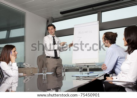 Business training in front of a panorama window