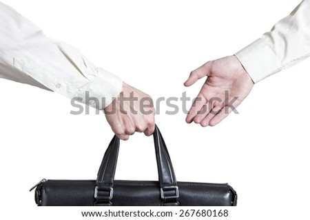 business transfer deal. handover of a suitcase for money partners