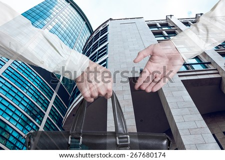business transfer deal. handover of a suitcase for money partners - stock photo