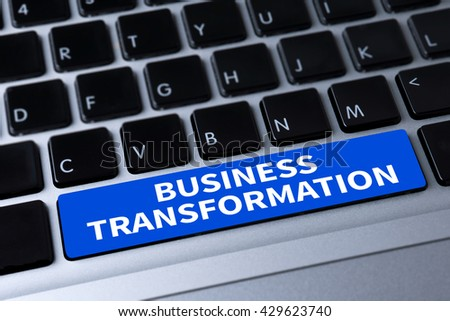 BUSINESS TRANSFORMATION a message on keyboard