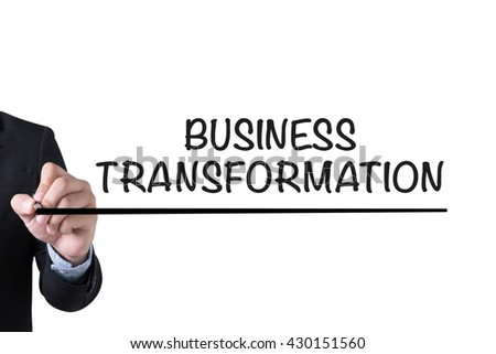 BUSINESS TRANSFORMATION  Businessman hand writing with black marker on white background