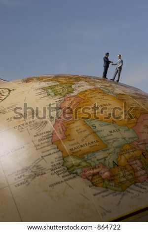 Business travel figure on globe - stock photo