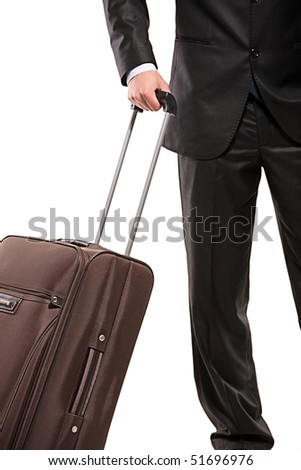 Business traveller with a suitcase isolated on white background (focus on the suitcase) - stock photo