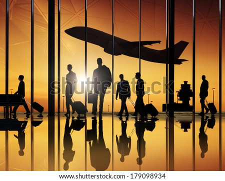 Business Travellers at Airport with 3D Airplane - stock photo