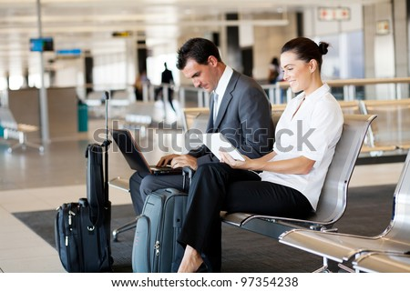 business travellers waiting for their flight at airport - stock photo