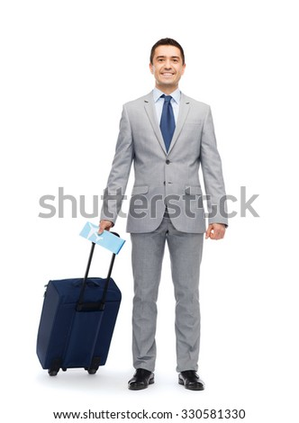 business trip, traveling, luggage and people concept - happy businessman in suit with travel bag and air ticket - stock photo