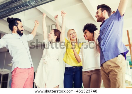 business, triumph, gesture, people and teamwork concept - happy creative team raising hands up and celebrating victory in office - stock photo