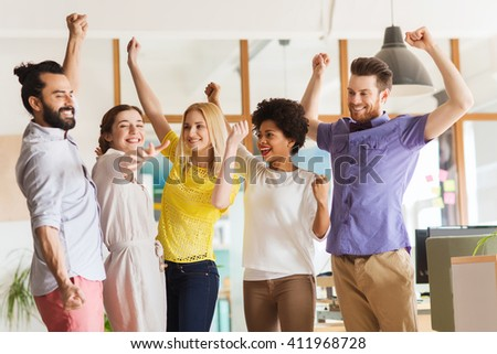 business, triumph, gesture, people and teamwork concept - happy international creative team raising hands up and celebrating victory in office - stock photo