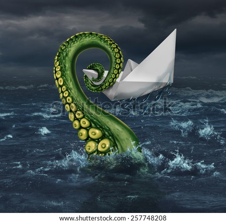 Business trouble and financial trap concept as an origami paper boat in a stormy sea being trapped by a monster tentacle squeezing the victim as a metaphor for career and entrepreneur risk. - stock photo