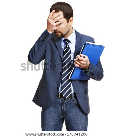 Business trouble / frustrated young man in an expensive suit have a problem - isolated on white background  - stock photo