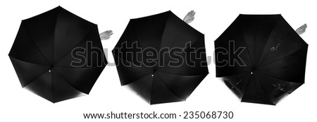 business umbrella with a single female hand poking out from the safety of the umbrella to see if it's raining - stock photo