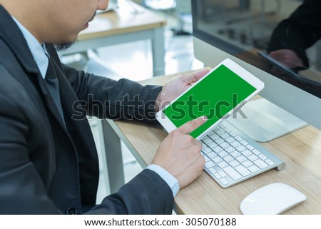 business using tablet  form office,man at his workplace using technology - stock photo