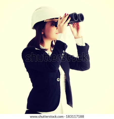 Business vision concept, engineer woman looking throught binoculars, isolated on white - stock photo