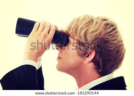 Business Vision concept - young man with binoculars - stock photo