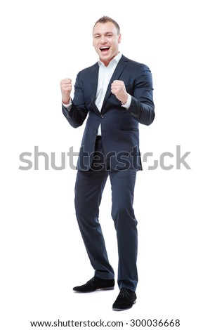 Business winner. Full length of happy young man in formalwear celebrating, gesturing, keeping arms raised and expressing positivity. Isolated on white. - stock photo