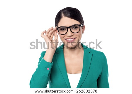 Business woman adjusting her eye glasses - stock photo