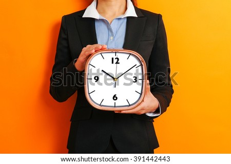 Business woman and alarm clock