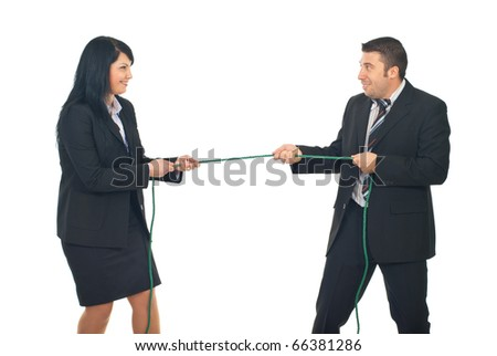 Business woman and business man in competition pulling a rope isolated on white background - stock photo