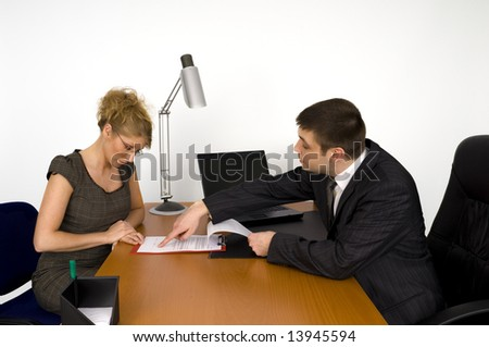 Business woman and businessman in office.